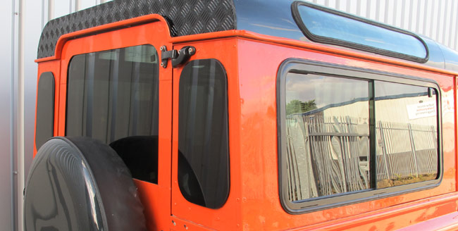 land rover defender windows